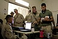 U.S. Marine Corps Sgt. James Stivers, left, with the Warfighter Express Services Team assigned to Combat Logistics Regiment 2, sells merchandise to a Marine with the 2nd Battalion, 7th Marine Regiment at Forward 130305-M-KS710-194.jpg