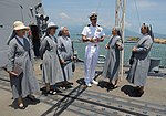 U.S. Navy Cmdr. Justin Orlich, center, the commanding officer of the guided missile destroyer USS Chung-Hoon (DDG 93), gives a tour of the ship to nuns in Da Nang, Vietnam, April 24, 2013 130424-N-YU572-017.jpg