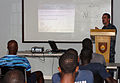 U.S. Navy Engineman 1st Class Kevin Nichols, right, speaks about small boat operations and navigation with members of the Barbados defense forces during a subject matter expert exchange in Bridgetown, Barbados 100824-N-GH121-012.jpg