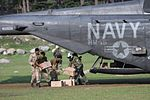 U.S. Navy sailors with Helicopter Mine Countermeasures Squadron 15, Detachment 2 help Pakistani soldiers offload relief supplies from a U.S. Navy MH-53E Sea Dragon helicopter during humanitarian relief efforts 100821-M-ZG155-757.jpg