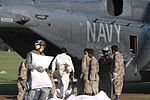 U.S. Sailors with Helicopter Mine Countermeasures Squadron (HM) 15, Detachment 2 help Pakistani soldiers load relief supplies onto a U.S. Navy MH-53E Sea Dragon helicopter during humanitarian relief efforts 100821-M-ZG155-660.jpg