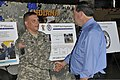 U.S. Sen. Joe Donnelly, right, talks with Army Maj. William Poag, an operations officer with the 19th Chemical, Biological, Radiological, Nuclear and Explosive Enhanced Response Force Package (CERFP), Indiana 130828-Z-PM441-839.jpg