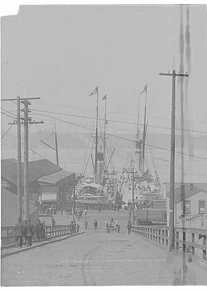 USAT ROSECRANS and LAWTON docked at the foot of University St in Seattle, preparing to transport US troops to China, 1900 (PEISER 134).jpeg