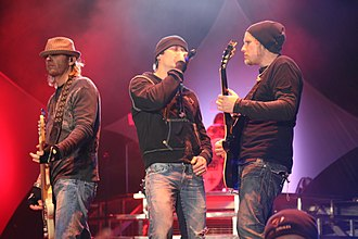 3 Doors Down - Todd Harrell, Brad Arnold and Matt Roberts performing in 2011.