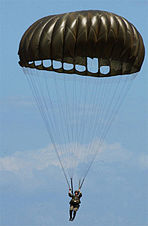 Soldier using a parachute