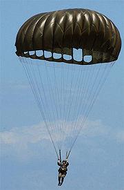 An American USMC Paratrooper using a MC1-B series parachute