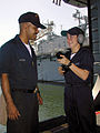 USS ESSEX (LHD 2) sailor Seaman Kristen Hancock from Batson, Texas discusses communication procedures with USS BELLEAU WOOD (LHA 3) crewman Aviation Structural Mechanic Airman (AMN) Edwin Rivera from Vegabaja 000719-N-IK959-005.jpg