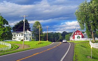 In New York, US 9 extends 325.01 miles (523.05 km) from the George Washington Bridge in Manhattan to an interchange with Interstate 87 just south of the Canada – United States border in the town of Champlain. Above: US 9 passes through a rural area north of Red Hook.