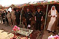 US Army 51784 Soldiers, Iraqi policemen and local leaders stand together to celebrate the validation of Hawijah Police Station 3 in Hawijah, Iraq, Sept. 3. Officers at this station will work closely with their U.S.jpg