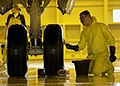 US Navy 030108-N-7171K-001 cleaning the tire rims on a P-3C.jpg