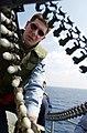 US Navy 030307-N-6141B-003 Fire Controlman 3rd Class Steven Goad from Virginia Beach, Va., loads 20mm ammunition into a Phalanx Mk-15 Close In Weapons System (CIWS) aboard USS Theodore Roosevelt (CVN 71).jpg