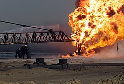 US Navy 030327-M-2306K-007 Firefighters fight an oil blaze in Gas-Oil Separation Plant Six as part of their ongoing support of Operation Iraqi Freedom