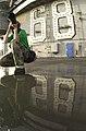 US Navy 030521-N-8273J-009 Photographer's Mate 3rd Class Yesenia Rosas photographs a flight deck cleaning exercise (SCRUBEX) on the flight deck aboard USS Nimitz (CVN 68).jpg