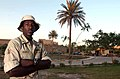 US Navy 030524-N-5362A-011 Construction Electrician 3rd Class Tamboura Murrell, stands in front of one of Saddam Hussein's former palaces, which overlooks the ruins of ancient Babylon, now part of Camp Babylon.jpg