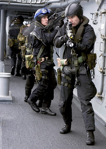 A Royal Marines team boards US Navy destroyer USS O'Bannon