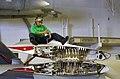 US Navy 040415-N-9964S-003 Airman Chris Gentry unscrews a panel on a S-3B Viking.jpg