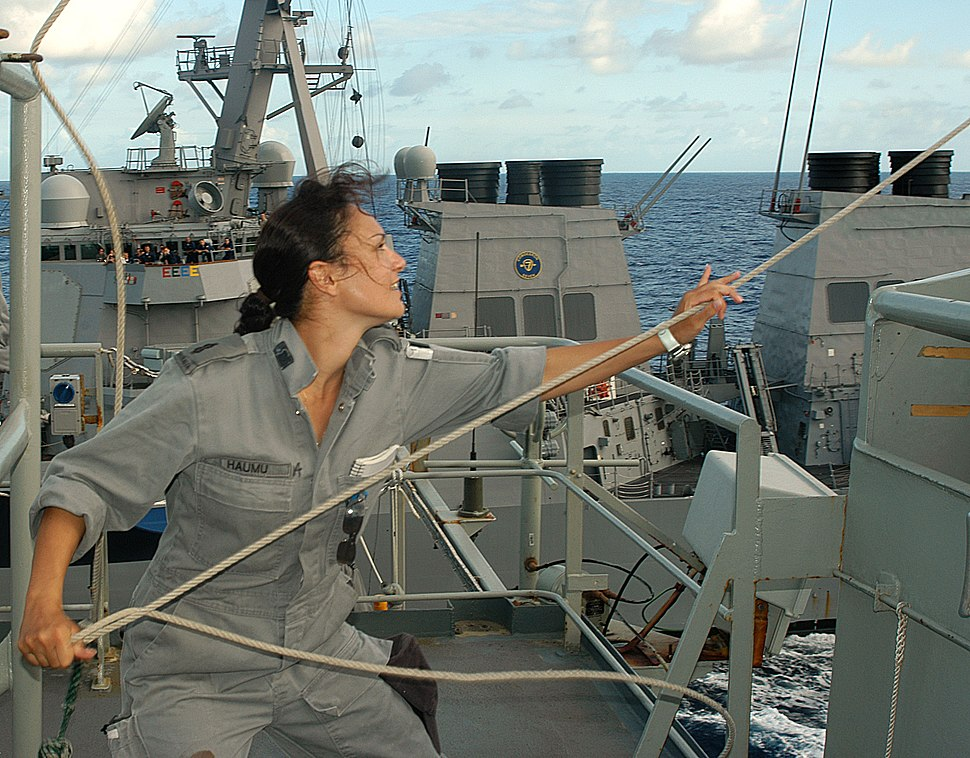 US Navy 040712-N-4304S-152 Aboard the Australian replenishment vessel HMAS Success (AOR 304), Able Seaman Communications Specialist Natalie Haumu, left, from Brisbane, Australia, retrieves a signal flag as the ship begins a Ref