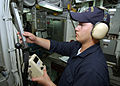 US Navy 040731-N-4374S-007 Fireman Joseph Dever performs a heat index survey in the auxiliary machinery room while standing a sound and security watch aboard the mine countermeasure ship USS Dextrous (MCM 13).jpg