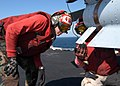 US Navy 041025-N-4565G-002 Aviation Ordnanceman 1st Class Leslie Raspberry, left, and Chief Aviation Ordnanceman Kevin Kling, inspect a AGM-65 Maverick missile during a preflight inspection of the ordnance on an F-A-18C Hornet.jpg