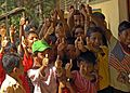 US Navy 050117-N-9951E-190 Indonesian children give a thumbs-up in celebration of relief aid near the town of Glebruk, one of the many coastal towns on the island of Sumatra, Indonesia hit by the Tsunami that struck South East.jpg