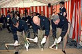 US Navy 050228-N-2970T-018 Officers from U.S. Fleet Activities Sasebo, Japan, use sickles to assist in the reclamation of the land during a Navy Exchange groundbreaking ceremony.jpg