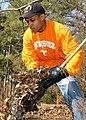 US Navy 050322-N-6278K-034 Aviation Electrician's Mate 2nd Class William Earnest of Johnson City, Tenn., helps remove leaves and debris at a Newport News Park in an ongoing effort by USS George Washington (CVN 73) to support co.jpg