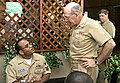 US Navy 050511-N-4204E-004 Chief of Naval Operations (CNO), Adm. Vern Clark, talk to Naval Air Technical Training Center (NATTC) instructor Aviation Electrician's Mate 1st Class Michael Santos.jpg