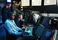 US Navy 050519-N-6410T-001 Air Traffic Controller 2nd Class Robert Mutter, standing, trains Air Traffic Controller Airmen Vector on Aircraft Scopes in the Carrier Air Traffic Control Center aboard the Nimitz-class aircraft carr.jpg