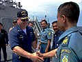 US Navy 050524-N-4104L-001 Commanding Officer, USS Paul Hamilton (DDG 60), Cmdr. Werner Jurinka, welcomes Indonesian Navy Capt. Salim of Tentara Nasional Indonesia Anekatan Laut to his ship for a tour.jpg
