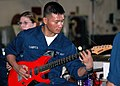 "US Navy 051211-N-7217H-025 Airman Paul Campita plays his guitar during a ""Steel Beach Picnic"" aboard the amphibious assault USS Tarawa (LHA 1).jpg"
