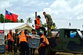 US Navy 060222-N-4772B-144 Philippine Army and Turkish rescue workers unload a vehicle filled with relief supplies during rescue efforts following a devastating landslide that struck southern Leyte on Feb. 17, 2006.jpg
