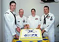 US Navy 060630-N-5932S-003 Sailors representing the four media ratings that will officially become the mass communication specialist rating join together to celebrate their rating merger.jpg
