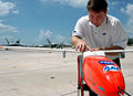 US Navy 060907-N-5240C-001 Director of Business Development Peter Bale readies an Unmanned Aerial Vehicle (UAV) for a test flight at Naval Air Station Key West.jpg