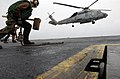 "US Navy 070316-N-7130B-029 An SH-60F Seahawk, assigned to the ""Black Knights"" of Helicopter Anti-Submarine Squadron (HS) 4, prepares to touch down on the flight deck of USS Ronald Reagan (CVN 76).jpg"