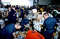 US Navy 070510-N-4420S-081 Sailors work together to sort the mail during replenishment at sea with Military Sealift Command (MSC) fleet replenishment oiler USNS Kanawha (T-AO 196).jpg