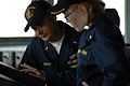 US Navy 070702-N-7498L-033 Lt. j.g. Richard Buckley, left, assists officer of the deck Lt j.g. Devon Willett by monitoring radar surface contacts from the bridge aboard guided-missile destroyer USS O'Kane (DDG 77).jpg