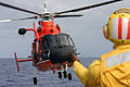 US Navy 071130-N-1008D-001 Boatswain's Mate 3rd Class David Burley directs a Coast Guard HH-65A from Honolulu, Hawaii Sector 13 aboard the guided-missile destroyer USS Russell (DDG 59) during a friends and family cruise to Maui.jpg