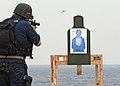US Navy 080204-N-0807W-084 A member of the visit, board, search and seizure (VBSS) security force aboard the amphibious dock landing ship USS Harpers Ferry (LSD 49) fires his weapon on the firing range during a target practice.jpg