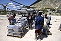 US Navy 080922-N-9620B-004 Haitian relief workers help United Nations and U.S. military service members embarked aboard the amphibious assault ship USS Kearsarge (LHD 3) unload food and water to aid those affected by the recent.jpg