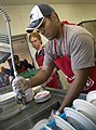 US Navy 090414-N-1722M-143 Personnel Specialist 3rd Class Reymundo Aguilar, assigned to the Arleigh Burke-class guided-missile destroyer USS Stockdale (DDG-106), cleans dishes at the Oxnard Rescue Mission.jpg