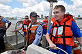 US Navy 090424-N-9712C-001 Engineman 2nd Class Todd Barrilleaux, assigned to Naval Support Activity New Orleans, teaches Navy Junior ROTC cadets how to drive a 50-foot utility boat.jpg