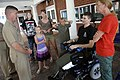 US Navy 090821-N-9818V-022 Master Chief Petty Officer of the Navy (MCPON) Rick West speaks with Marine Corps Sgt. Joshua Boucard and his family during his visit to the Hunter Holmes McGuire Richmond VA Medical Center.jpg