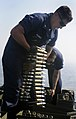 US Navy 090901-N-7280V-167 Gunner's Mate 2nd Class Joshua Pacheco downloads ammunition from a Phalanx Close-In Weapons System (CIWS).jpg