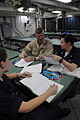 US Navy 090912-N-4995K-273 Master Chief Petty Officer of the Navy (MCPON) Rick West speaks with Mass Communication Specialist Seaman Apprentice Amanda Ray and Electrician's Mate 3rd Class Jessica Buchanan on the mess decks of t.jpg