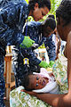 US Navy 100125-N-8878B-206 Culinary Specialist 1st Class Naqueline Shaw assists Chief Hospital Corpsman Carletus Patrick in treating patients.jpg