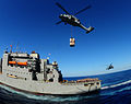 US Navy 100127-N-7508R-121 An MH-60S Sea Hawk helicopter from Helicopter Sea Combat Squadron (HSC) 22 prepares to carry supplies from the Military Sealift Command.jpg