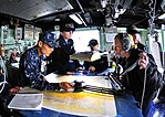 US Navy 100316-N-4774B-628 Quartermasters aboard the guided-missile cruiser USS Bunker Hill (CG 52) chart a course as the ship transits the Straight of Magellan.jpg