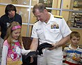 US Navy 100326-N-2389S-046 Rear Adm. Barry Bruner, commander of Submarine Group 10, hands out ball caps during a Caps for Kids event at a local Phoenix hospital during Phoenix Navy Week.jpg
