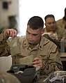 US Navy 100329-N-6932B-781 Air Traffic Controller 2nd Class David Allen Shoemaker experiences his first meal-ready-to-eat (MRE) during the U.S. Navy Individual Augmentee Combat Training course at Fort Jackson, S.C.jpg