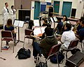 US Navy 100427-N-4716P-042 Musician Seaman Brooke Knight and Musician 3rd Class Gene Register speak to the G. Holmes Braddock Senior High School band about careers in the Navy's music program during Fleet Week Port Everglades.jpg
